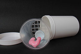 Cup used for cleaning of ear moulds